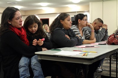 Parents at Desert Trails Elementary School in Adelanto, Ca. wait for the board to vote. (Photo by Natasha Lindstrom)