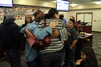 Parents hug after the vote. (Photo by Natasha Lindstrom)